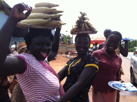 Some lovely ladies who work at the toll between Kumasi and Konongo. Corn [maize] is in season! Fast food...Ghana style.