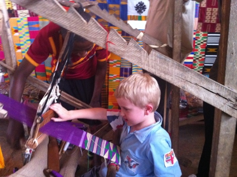 Trying his hand at weaving kente
